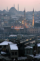New Mosque with the Beyazit Mosque behind it at dusk in the winter, Istanbul, Turkey