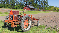 Plowing field with Electric TractorCommunity Supported Agriculture Farm, 47th Avenue Farm, plowed and ready for sprint planting.  Luscher Farms Park, City of Lake Oswego, Oregon, USA.