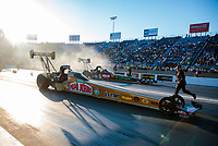 Jun 1, 2018; Joliet, IL, USA; NHRA top fuel driver Leah Pritchett (near) alongside Terry McMillen during qualifying for the Route 66 Nationals at Route 66 Raceway. Mandatory Credit: Mark J. Rebilas-USA TODAY Sports