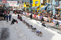 Aliy Zirkle leaves the 4th avenue Ceremonial Start of the 2016 Iditarod in Anchorage, Alaska.  March 05, 2016