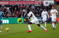 SWANSEA, WALES - FEBRUARY 07: Bafetimbi Gomis of Swansea moves forward with the ball during the Premier League match between Swansea City and Sunderland AFC at Liberty Stadium on February 7, 2015 in Swansea, Wales.