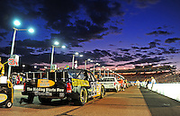 Nov. 13, 2009; Avondale, AZ, USA; The truck of NASCAR Camping World Truck Series driver Jason White sits on pit road as the sun sets prior to the Lucas Oil 150 at Phoenix International Raceway. Mandatory Credit: Mark J. Rebilas-