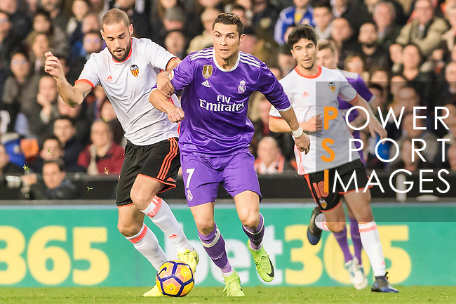 Cristiano Ronaldo (r) of Real Madrid competes for the ball with Mario Suarez Mata of Valencia CF during their La Liga match between Valencia CF and Real Madrid at the Estadio de Mestalla on 22 February 2017 in Valencia, Spain. Photo by Maria Jose Segovia Carmona / Power Sport Images