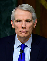 """United States Senator Rob Portman (Republican of Ohio) listens to the testimony before the US Senate Committee on Homeland Security and Governmental Affairs Permanent Subcommittee on Investigations during a hearing on """"Examining Private Sector Data Breaches"""" on Capitol Hill in Washington, DC on Thursday, March 7, 2019.<br /> Credit: Ron Sachs / CNP/AdMedia"""