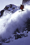 A woman jumping while skiing at Squaw Valley, CA.