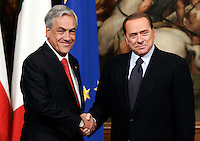 Il Presidente del Consiglio Silvio Berlusconi, a destra, stringe la mano al Presidente della Repubblica del Cile Sebastian Pinera a Palazzo Chigi, Roma, 2 marzo 2011..Italian Premier Silvio Berlusconi, right, shakes hands with Chilean President Sebastian Pinera, at Chigi Palace, Rome, 2 march 2011..UPDATE IMAGES PRESS/Riccardo De Luca