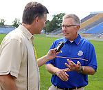 BROOKINGS, SD - AUGUST 11: John Stiegelmeier,<br /> Head Coach of South Dakota State University football talks to Jeff Harkness Monday afternoon at the Jacks Media Day in Brookings. (Photo by Dave Eggen/Inertia)