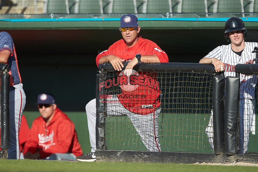 Hagerstown Suns manager Patrick Anderson (22) watches from the top step of the dugout during the game against the Kannapolis Intimidators at Kannapolis Intimidators Stadium on May 6, 2018 in Kannapolis, North Carolina. The Intimidators defeated the Suns 4-3. (Brian Westerholt/Four Seam Images)