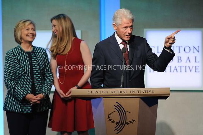 WWW.ACEPIXS.COM<br /> September 24, 2013 New York City<br /> <br /> Hillary Rodham Clinton, Chelsea Clinton and  Bill Clinton on stage during the annual Clinton Global Initiative (CGI) meeting on September 24, 2013 in New York City.<br /> <br /> By Line: Kristin Callahan/ACE Pictures<br /> <br /> ACE Pictures, Inc.<br /> tel: 646 769 0430<br /> Email: info@acepixs.com<br /> www.acepixs.com<br /> <br /> Copyright: Kristin Callahan/ACE Pictures