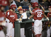 NWA Democrat-Gazette/ANDY SHUPE<br /> Arkansas second baseman Jack Kenley (left) congratulates pinch-runner Curtis Washington Jr.  Friday, May 10, 2019, after he and first baseman Trevor Ezell scored during the eighth inning against LSU at Baum-Walker Stadium in Fayetteville. Visit nwadg.com/photos to see more photographs from the game.