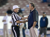 California head coach Sonny Dykes shakes hands with referee Shawn Hochuli before the game at Rose Bowl in Pasadena, California on October 12th, 2013.   UCLA defeated California, 37-10.