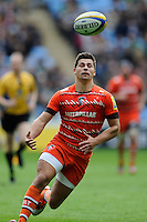 Ben Youngs of Leicester Tigers chases after a loose ball