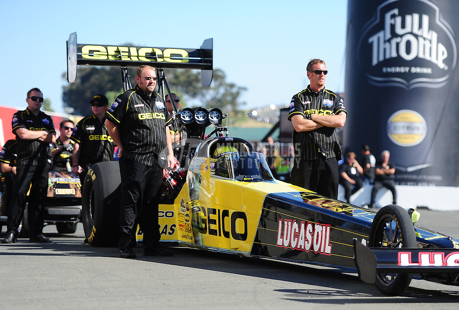 Jul. 29, 2011; Sonoma, CA, USA; NHRA top fuel dragster crew members for driver Morgan Lucas during qualifying for the Fram Autolite Nationals at Infineon Raceway. Mandatory Credit: Mark J. Rebilas-