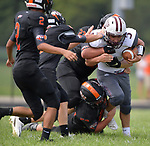 Dupo running back Lucas Rea is swarmed by Wesclin players. Wesclin defeated Dupo 34-30 on Saturday August 31, 2019 in a game that was stopped Friday night at halftime due to storms. <br /> Tim Vizer/Special to STLhighschoolsports.com