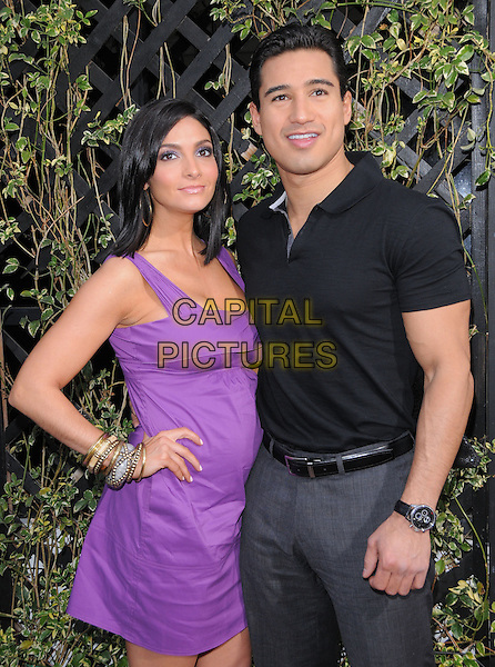 COURTNEY LAINE MAZZA & MARIO LOPEZ.The Eva by Eva Longoria Fragrance Launch held at Beso in Hollywood, California, USA. .April 27th, 2010.perfume half length purple dress hand on hip grey gray trousers black top couple.CAP/RKE/DVS.©DVS/RockinExposures/Capital Pictures.