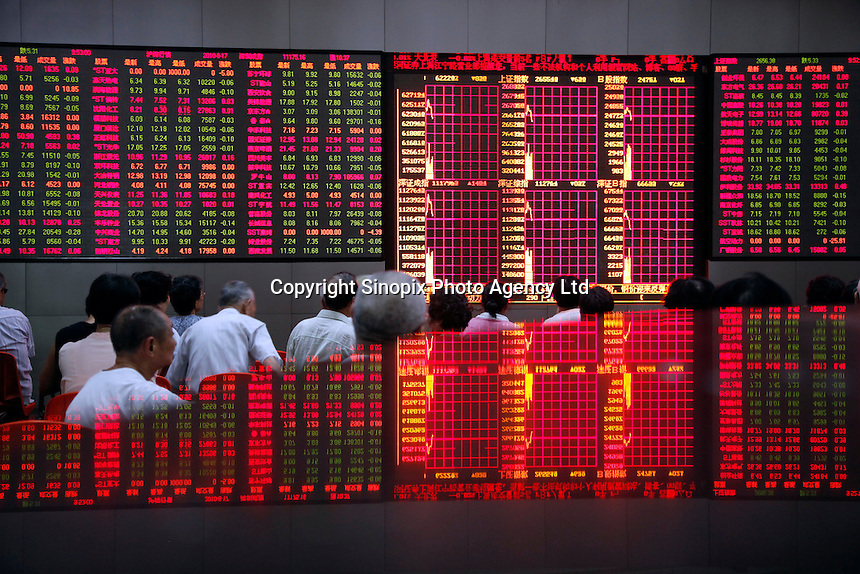 A stock display is reflected on a tabletop while investors monitor ...the trade stocks at a securities exchange house in Shanghai, China. The Shanghai Stock Exchange (SSE) is one of the three stock exchanges operating independently in the People's Republic of China, the other two are the Shenzhen Stock Exchange and the Hong Kong Stock Exchange. It is the world's sixth largest stock market by market capitalization at US$2.4 trillion as of Aug 2010..17 Aug 2010