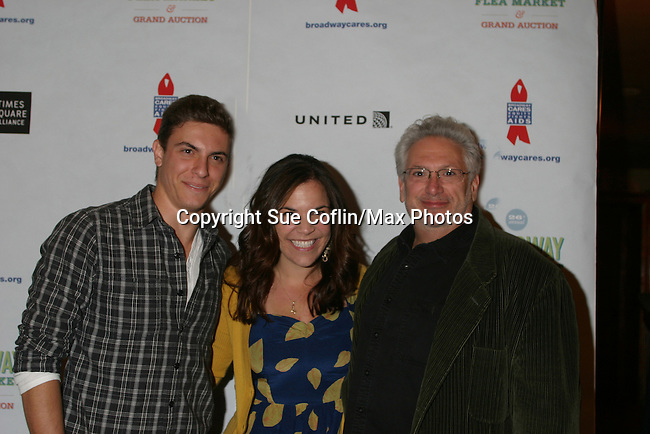 """Dogfight's Derek Klena and Lindsay Mendez have fun with Harvey Fierstein """"Kinky Boots"""" at The 26th Annual Broadway Flea Market and Grand Auction to benefit Broadway Cares/Equity Fights Aids on September 23, 2012 in Shubert Alley and Times Square, New York City, New York.  (Photo by Sue Coflin/Max Photos)"""