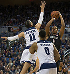 San Diego State forward Matt Mitchell (11) shoots over the out stretched arm of Nevada forward Cody Martin (11) in the first half of an NCAA college basketball game in Reno, Nev., Saturday, March 9, 2019. (AP Photo/Tom R. Smedes)