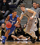 SIOUX FALLS, SD - MARCH 10:  Pierre Bland #2 of IPFW shields the ball from Travis Bader #3 of Oakland University during their quarterfinal game at the 2013 Summit League Basketball Championships at the Sioux Falls Arena Sunday. (Photo by Dick Carlson/Inertia)