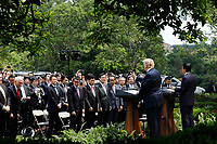 United States President Donald Trump and Prime Minister of Japan Shinzo Abe hold a joint news conference in the Rose Garden of the White House after their meeting on June 7, 2018 in Washington, DC. <br /> CAP/MPI/RS<br /> &copy;RS/MPI/Capital Pictures