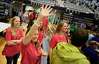 NWA Democrat-Gazette/DAVID GOTTSCHALK   Heather Bottoms, an eighth grade english teacher at Ramay Junior High School, waves Friday, August 11, 2017, prior to the start of the Imagine the Possibilities Fayetteville Public Schools Convocation 2017 inside the high school arena on the campus. The convocation included performances with the high school band, keynote speaker Matthew Wendt, superintendent of schools followed by the 30th annual Fayetteville Education Expo.