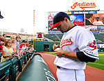 4 September 2009: Cleveland Indians' utilityman Jamey Carroll signs autographs prior to a game against the Minnesota Twins at Progressive Field in Cleveland, Ohio. Carroll went 3 for 5 as the Indians defeated the Twins 5-2 to take the first game of their three-game weekend series. Mandatory Credit: Ed Wolfstein Photo