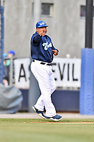 Asheville Tourists manager Robinson Cancel (37) gives signals during a game against the Columbia Fireflies at McCormick Field on April 14, 2018 in Asheville, North Carolina. The Fireflies defeated the Tourists 7-6. (Tony Farlow/Four Seam Images)