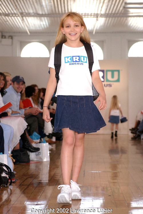 Model Jamie Lynn Spears wears a KRU logo tee and a denim pleated skirt  April 11, 2002, in New York. These items are part of the Fall 2002 Kids R Us fashion collection..