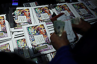 New York, United States. 23th March 2014 - People buy a DVDs of Celia Cruz during a special concert to commemorate the life and legacy of Celia Cruz at the Apollo theater in Harlem, New York. Photo by Eduardo Munoz Alvarez/VIEW