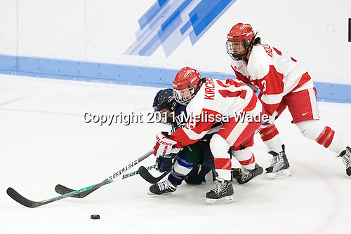 Vicki Bendus (Mercyhurst - 11), Jillian Kirchner (BU - 18), Kasey Boucher (BU - 3) - The Boston University Terriers defeated the visiting Mercyhurst College Lakers 4-2 in their NCAA Quarterfinal matchup on Saturday, March 12, 2011, at Walter Brown Arena in Boston, Massachusetts.