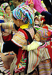 Flower Hmong Baby 03 - Traditionally dressed Flower Hmong woman with baby in a back carrier, Sunday market, Bac Ha, NW Viet Nam