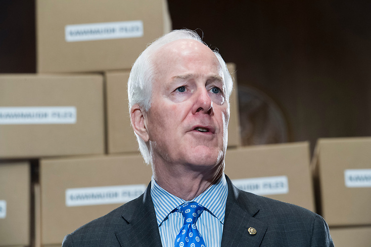 UNITED STATES - AUGUST 02: Sen. John Cornyn, R-Texas, conducts a news conference in Dirksen Building on August 2, 2018, with boxes representing roughly 1 million pages of documents to be submitted to the Senate Judiciary Committee on Supreme Court nominee Brett Kavanaugh. (Photo By Tom Williams/CQ Roll Call)