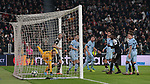 Jan Oblak in the Atletico Madrid goal can only look on along with Leonardo Bonucci of Juventus as Paulo Dybala of Juventus's free kick enters directly into the goal from a narrow angle during the UEFA Champions League match at Juventus Stadium, Turin. Picture date: 26th November 2019. Picture credit should read: Jonathan Moscrop/Sportimage