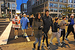Denis Brogniart, French host of French reality television show Survivor, leaves his hotel with his wife Hortense Brogniart and fellow French runners before the Chicago Marathon in Chicago, Illinois on October 11, 2009.