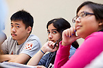Jerry Zhang, left, and Ashley Vasquez participate in a discussion during Professor Gretchen Ritter's course, Debates on Democracy, at the University of Texas at Austin on Monday, September 17, 2012. The Supreme Court will hear a major case involving race concious admissions and affirmative action at the University of Texas..Ben Sklar for the New York Times.