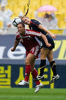 USWNT defender (26) Rachel Buehler goes up for a header with Canada's (14) Melissa Tancredi during the finals of the Peace Queen Cup.  The USWNT defeated Canada, 1-0, at Suwon World Cup Stadium in Suwon, South Korea.