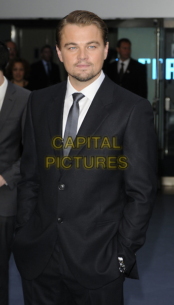 LEONARDO DICAPRIO .At the World Premiere of 'Inception' at the Odeon Leicester Square cinema, Leicester Square, London, England, .UK, July 8th 2010..arrivals half length black suit tie white shirt hands in pockets leo di caprio facial hair goatee beard .CAP/CAN.©Can Nguyen/Capital Pictures.