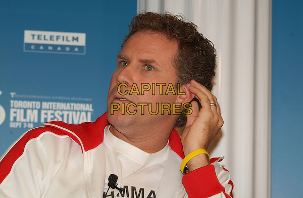 """WILL FERRELL.""""Stranger Than Fiction"""" Press Conference during the 2006 Toronto International Film Festival held at Sutton Place Hotel, Toronto, Ontario, Canada..September 9th, 2006.Ref: ADM/BP.headshot portrait hand yellow rubber bracelet.www.capitalpictures.com.sales@capitalpictures.com.©Brent Perniac/AdMedia/Capital Pictures."""