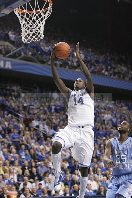 UK forward Michael Kidd-Gilchrist goes to the basket while North Carolina guard Reggie Bullock watches from behind during the first half of UK's home game against North Carolina at Rupp Arena in Lexington, Ky., Dec. 1, 2011. Photo by Brandon Goodwin