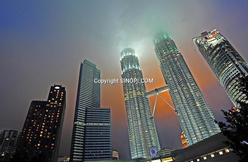 The Petronas Towers in Kuala Lumpur, Malaysia. <br /> 31-Oct-11<br /> <br /> <br /> <br /> <br /> <br /> <br /> <br /> <br /> <br /> <br /> <br /> <br /> <br /> The Petronas Towers and other skyscapers in the Central Business District at Kuala Lumpur, Malaysia,<br /> 02-Nov-11