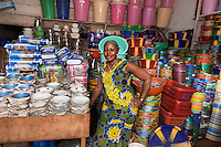 BRAC micro-finance project. Gbongar Kamara, woman got BRAC loan and selling plastic goods in Red Hill market, makes about $300 US.