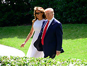 United States President Donald J. Trump and first lady Melania Trump walk from the Oval Office as they prepare to depart the South Lawn of the White House in Washington, DC for Orlando Florida where the President will formally announce he is a candidate for re-election on Tuesday. June 18, 2019.<br /> Credit: Ron Sachs / CNP