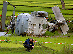 Quality assurance officer Lt. Commander Ron Guston guard the scene of a helicopter crash.  A U.S. Navy H-60 Sea Hawk helicopter from the U.S.S. Abraham Lincoln based out of San Diego crashed upon aproach at the airport in the Aceh District of Indonesia.  10 military personnel were on board.  There were no fatalities reported. 100,000 are estimated to be dead and hundreds of thousands are left homeless in Indonesia because of the tsunami.  Photo taken Monday, January 10, 2005.  Photo by Khampha Bouaphanh