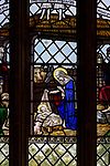 Stained glass window of nativity church of Saint Mary, Hemington, Somerset, England, UK