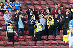 Motherwell v St Johnstone&hellip;13.08.16..  Fir Park  SPFL<br />A saints fan is removed from the ground by Police<br />Picture by Graeme Hart.<br />Copyright Perthshire Picture Agency<br />Tel: 01738 623350  Mobile: 07990 594431