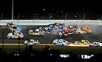 Jul. 2, 2011; Daytona Beach, FL, USA; NASCAR Sprint Cup Series drivers Mark Martin (5), Martin Truex Jr (56), Travis Kvapil (38), Clint Bowyer (33), Joe Nemechek (87), Landon Cassill (51), Regan Smith (78), Tony Stewart (14) and Brian Vickers (83) crash as Dale Earnhardt Jr (88) goes low to avoid during the Coke Zero 400 at Daytona International Speedway. Mandatory Credit: Mark J. Rebilas-