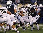 Nevada's James Butler (20) runs against UC Davis in an NCAA college football game in Reno, Nev. on Thursday, Sept. 3, 2015. (AP Photo/Cathleen Allison)