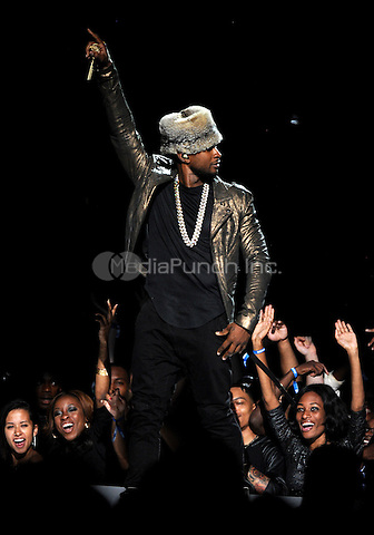 LOS ANGELES, CA - JUNE 29 : Usher performs onstage at the BET Awards '14 at Nokia Theatre L.A. Live on June 29, 2014 in Los Angeles, California. Credit: PGMicelotta/MediaPunch