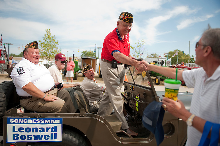 UNITED STATES - AUGUST 15:  Rep. Leonard Boswell, D-Iowa, a Vietnam veteran, greets a supporter during the Veteran's parade at the Iowa State Fair in Des Moines, Iowa.  (Photo By Tom Williams/Roll Call)