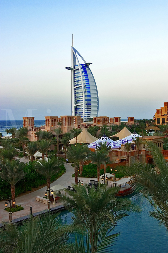 Dubai, United Arab Emirates. Burj al Arab Hotel and Mina A'Salam Hotel. Madinat Jumeirah. Evening..